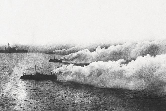 British ships laying a smokescreen
