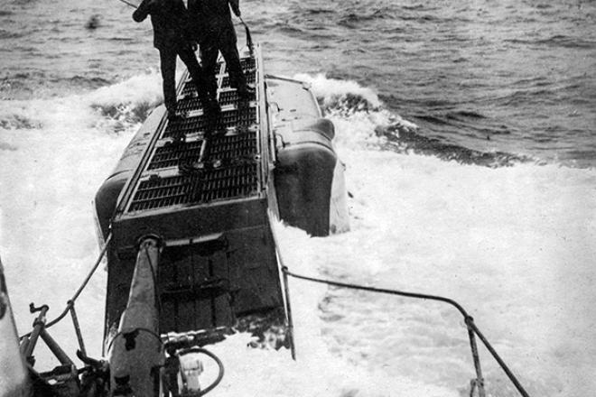 2 crewmen on the bough of their submarine